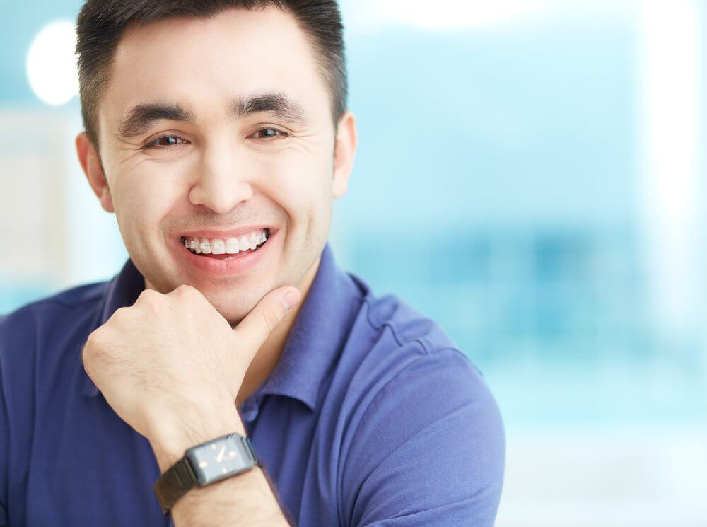 Man with oral appliance smiling