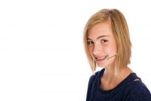 Girl with oral appliance smiling