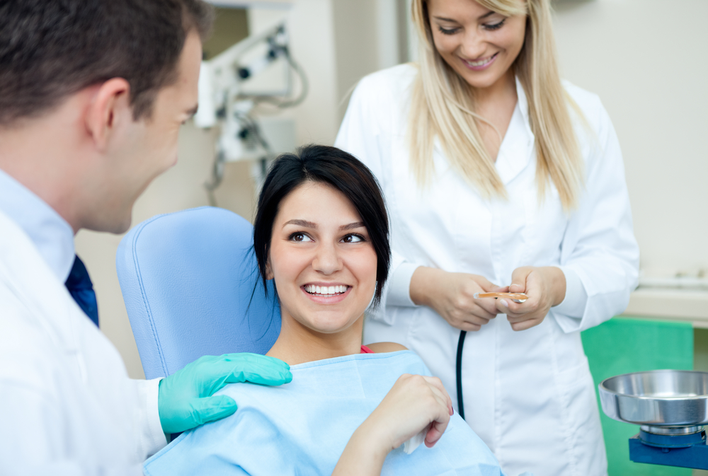 woman sitting in the dental chair smiling